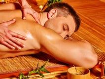 Man getting bamboo massage Stock Image