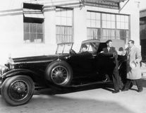 Man getting into car with chauffer. (All persons depicted are no longer living and no estate exists. Supplier grants that there will be no model release issues Stock Image