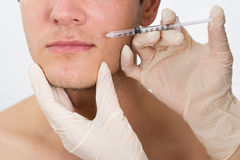 Man Getting Cosmetic Injection In His Face Stock Image