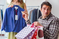 The man getting into debt due to shopping. Man getting into debt due to shopping Royalty Free Stock Photography