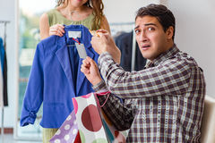 The man getting into debt due to shopping Royalty Free Stock Photos