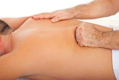 Man getting deep back massage stock photos