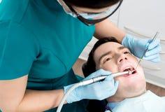 Man getting a dental checkup Royalty Free Stock Photo