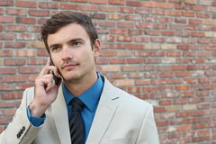 Man getting a disturbing information on the phone Royalty Free Stock Image