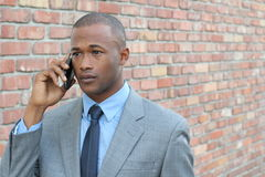 Man getting a disturbing new on the phone Royalty Free Stock Photography