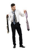 Man getting dressed choosing among many neckties. Stock Photography