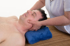 Man getting a facial / face massage at day spa Royalty Free Stock Images