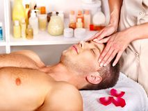 Man getting  facial massage . Stock Photo