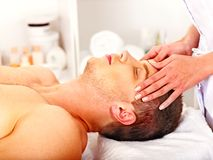 Man getting  facial massage . Stock Photos