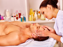 Man getting  facial massage Stock Images