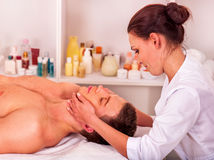 Man getting  facial massage Stock Photos