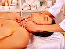 Man getting  facial massage Royalty Free Stock Photography
