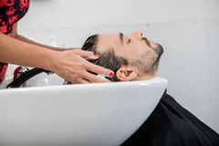Man Getting Hair Washed In Parlor Stock Images