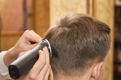 Man getting haircut close up. Royalty Free Stock Images