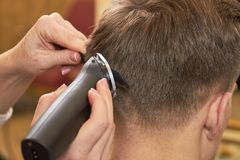 Man getting haircut, close up. Royalty Free Stock Images