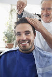 Man Getting An Haircut From Hairdresser Royalty Free Stock Photography