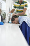 Man Getting Hairwash By Hairdresser Stock Photo