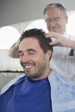 Man Getting A Head Massage From Hairdresser Royalty Free Stock Photography