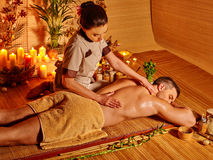 Man getting herbal ball massage treatments Stock Photography