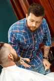 Man getting his beard shaved in a barber shop Royalty Free Stock Photos