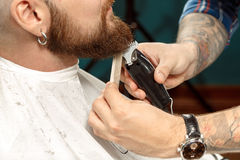 Man getting his beard shaved in a barber shop royalty free stock photo
