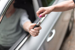 Man getting his car keys Royalty Free Stock Photos