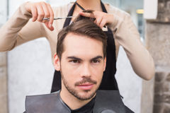 Man getting his hair trimmed Stock Photo