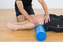 Man getting his knee examined by a physical therapist Stock Photography