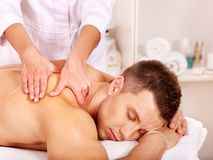 Man getting massage in spa. Royalty Free Stock Photo
