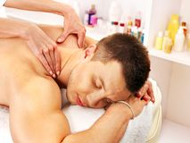 Man getting massage in spa. Stock Photo