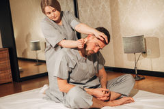 Man getting massage in spa. Female therapist Royalty Free Stock Photography