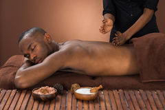 Man Getting Massage In Spa Royalty Free Stock Photos