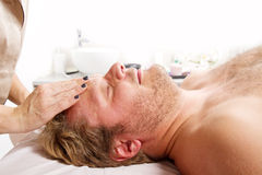 Man getting massage in thebeauty center Stock Images