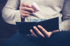 Man getting money out of his wallet Stock Photos