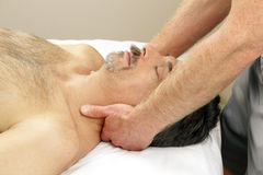 Man Getting Neck Massage. Male receiving massage therapy from hands of a man Stock Images