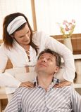 Man getting neck massage Stock Photos