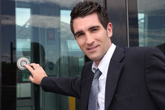 Man getting onto tram stock photography