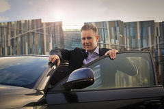 Man getting out of a car Royalty Free Stock Images