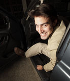 Man getting out of his car Stock Photography