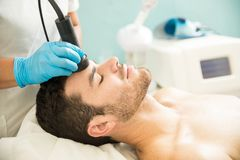 Man getting a radiofrequency facial Royalty Free Stock Images