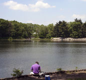 Man getting ready. Man ready to fish Royalty Free Stock Images