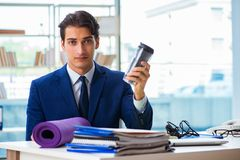 The man getting ready for sports break in the office. Man getting ready for sports break in the office stock photos