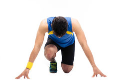 Man getting ready to run Stock Images