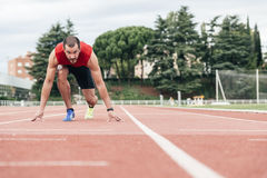 Man getting ready to start running. Royalty Free Stock Images