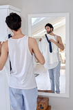 Man getting ready for work Stock Photography