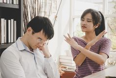Man getting rejected by beautiful woman stock photo