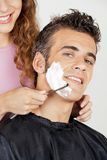 Man Getting A Shave From Barber Stock Images
