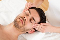 Man getting spa treatment Stock Photography