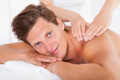Man getting spa treatment Stock Image