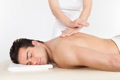 Man getting spa treatment Stock Photo